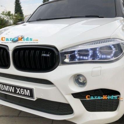 Детский электромобиль BMW X6M BLUE 12V - JJ2168 (2х местный, колеса резина, кресло кожа, пульт, музыка)